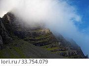 Купить «Wolken vor blauem Himmel am Berg Mosfell, Ostisland, Island, Europa», фото № 33754079, снято 28 мая 2020 г. (c) age Fotostock / Фотобанк Лори