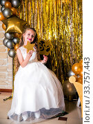 Portrait of girl princess in white dress with gold star holding stars in his hands. Стоковое фото, фотограф Евгений Ткачёв / Фотобанк Лори