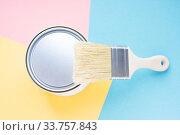 Купить «Paint metal round can and new brush on multi-colored background. Focus on brush. House renovation. Hobby.», фото № 33757843, снято 3 мая 2020 г. (c) Papoyan Irina / Фотобанк Лори