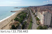Купить «Aerial view of Mataro with buildings and coast line in the Spain», видеоролик № 33758443, снято 24 ноября 2019 г. (c) Яков Филимонов / Фотобанк Лори