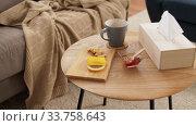 Купить «cup of tea, lemon, honey and ginger at home», видеоролик № 33758643, снято 26 апреля 2020 г. (c) Syda Productions / Фотобанк Лори