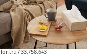 cup of tea, lemon, honey and ginger at home. Стоковое видео, видеограф Syda Productions / Фотобанк Лори