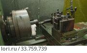Купить «Piece of machinery in the workshop at a factory turning with cooling jet of liquid», видеоролик № 33759739, снято 23 ноября 2019 г. (c) Wavebreak Media / Фотобанк Лори