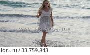 Купить «Caucasian woman enjoying her time seaside», видеоролик № 33759843, снято 13 марта 2020 г. (c) Wavebreak Media / Фотобанк Лори