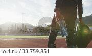 Купить «Disabled mixed race man with prosthetic legs walking on a race track », видеоролик № 33759851, снято 17 марта 2020 г. (c) Wavebreak Media / Фотобанк Лори
