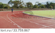 Купить «Disabled mixed race man with prosthetic legs running on race track», видеоролик № 33759867, снято 17 марта 2020 г. (c) Wavebreak Media / Фотобанк Лори