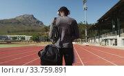 Купить «Disabled mixed race man with prosthetic legs walking on race track and listening to music », видеоролик № 33759891, снято 17 марта 2020 г. (c) Wavebreak Media / Фотобанк Лори