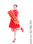 Купить «Young asian woman in red cheongsam holds red couplet in chinese new year», фото № 33760707, снято 14 июля 2020 г. (c) age Fotostock / Фотобанк Лори