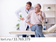 Купить «Young male doctor and old patient in antismoking concept», фото № 33769379, снято 9 сентября 2019 г. (c) Elnur / Фотобанк Лори