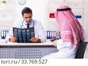 Купить «Old male arab visiting young male doctor», фото № 33769527, снято 16 августа 2019 г. (c) Elnur / Фотобанк Лори
