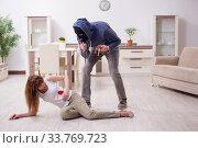 Купить «Gangster and young woman in robbery concept», фото № 33769723, снято 15 мая 2019 г. (c) Elnur / Фотобанк Лори