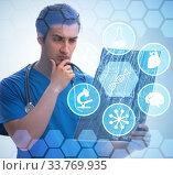Купить «Doctor looking at x-ray image in telehealth concept», фото № 33769935, снято 2 июня 2020 г. (c) Elnur / Фотобанк Лори