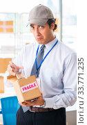 Купить «Male employee working in box delivery relocation service», фото № 33771235, снято 24 июля 2018 г. (c) Elnur / Фотобанк Лори