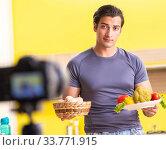 Young man blogging about food supplements. Стоковое фото, фотограф Elnur / Фотобанк Лори