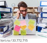 Businessman struggling with multiple priorities. Стоковое фото, фотограф Elnur / Фотобанк Лори