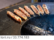 Grilled appetizing kebab cooking on wooden skewers. Стоковое фото, фотограф FotograFF / Фотобанк Лори