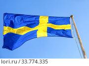 Купить «National flag of Sweden flying in the wind», фото № 33774335, снято 14 сентября 2019 г. (c) FotograFF / Фотобанк Лори