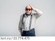 Купить «Elderly man with mustache poses in sunglasses», фото № 33774475, снято 7 февраля 2020 г. (c) Tryapitsyn Sergiy / Фотобанк Лори