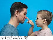Купить «Portrait of positive handsome man and little child wearing stylish eyeglasses», фото № 33775791, снято 10 марта 2019 г. (c) Pavel Biryukov / Фотобанк Лори