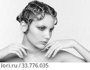 Купить «Black and white portrait in high key tone of woman with creative hairdo braid», фото № 33776035, снято 30 января 2012 г. (c) Serg Zastavkin / Фотобанк Лори