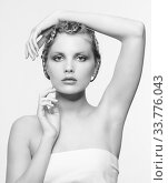 Купить «Black and white portrait in high key tone female with creative hairdo braids», фото № 33776043, снято 30 января 2012 г. (c) Serg Zastavkin / Фотобанк Лори