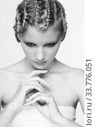 Купить «Black and white portrait in high key tone female with creative hairdo braids», фото № 33776051, снято 30 января 2012 г. (c) Serg Zastavkin / Фотобанк Лори