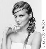 Купить «Black and white portrait in high key tone female with creative hairdo braids», фото № 33776067, снято 30 января 2012 г. (c) Serg Zastavkin / Фотобанк Лори