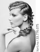 Купить «Black and white portrait in high key tone female with creative hairdo braids», фото № 33776075, снято 30 января 2012 г. (c) Serg Zastavkin / Фотобанк Лори