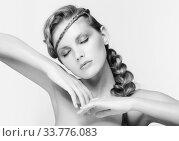 Купить «Black and white portrait in high key tone female with creative hairdo braids», фото № 33776083, снято 30 января 2012 г. (c) Serg Zastavkin / Фотобанк Лори