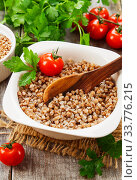 Buckwheat in a bowl. Стоковое фото, фотограф Надежда Мишкова / Фотобанк Лори