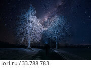 Купить «Silhouette of hiker person with flashlight on head watching the starry sky and tree on the road», фото № 33788783, снято 30 мая 2020 г. (c) easy Fotostock / Фотобанк Лори