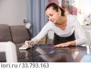 Купить «Woman with rag cleaning kitchen table», фото № 33793163, снято 27 мая 2020 г. (c) Яков Филимонов / Фотобанк Лори