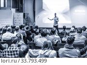 Male public peaker giving presentation on business conference event. Стоковое фото, фотограф Matej Kastelic / Фотобанк Лори