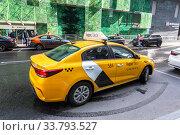 Купить «Modern car of Yandex Taxi on the city street», фото № 33793527, снято 9 июля 2019 г. (c) FotograFF / Фотобанк Лори