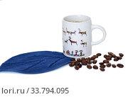 Cup of coffee on blue napkin and coffee beans. Стоковое фото, фотограф Валерия Попова / Фотобанк Лори