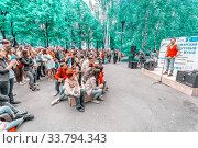 """Купить «Russia, Samara, July 2017: young people listen to a lecture on the embankment at the festival """"Volgafest"""" on a summer day. Text in Russian: museum, gold.», фото № 33794343, снято 11 июня 2017 г. (c) Акиньшин Владимир / Фотобанк Лори"""