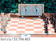 Купить «Tables with chessboard prepared for lovers on the embankment of the Volga River in a summer sunny day.», фото № 33794403, снято 12 августа 2017 г. (c) Акиньшин Владимир / Фотобанк Лори