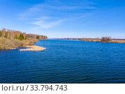 Купить «Wide Uvodsky reservoir with blue water of the reflected sky, Russia», фото № 33794743, снято 2 мая 2020 г. (c) Валерий Смирнов / Фотобанк Лори
