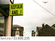 Купить «Writing note showing Keep Calm And. Business concept for motivational poster produced by British government Green ad board on the street with copy space for advertisement», фото № 33800235, снято 28 мая 2020 г. (c) easy Fotostock / Фотобанк Лори