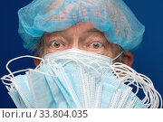 Купить «Portrait of senior adult fearful glance in medical face mask covering nose and mouth from SARS, 2019-ncov infection», фото № 33804035, снято 16 мая 2020 г. (c) А. А. Пирагис / Фотобанк Лори