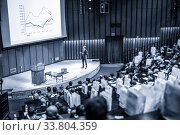 Speaker giving presentation on business conference event. Стоковое фото, фотограф Matej Kastelic / Фотобанк Лори
