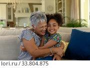 Купить «Senior mixed race woman with her granddaughter at home», фото № 33804875, снято 28 ноября 2019 г. (c) Wavebreak Media / Фотобанк Лори