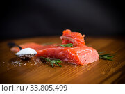 salty red fish on a fork, wooden background. Стоковое фото, фотограф Peredniankina / Фотобанк Лори