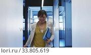 Купить «Businesswoman celebrating in modern office», видеоролик № 33805619, снято 12 октября 2019 г. (c) Wavebreak Media / Фотобанк Лори