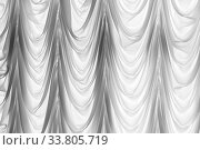 Decorative white tulle with folds, background photo. Стоковое фото, фотограф EugeneSergeev / Фотобанк Лори