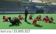 Купить «Hockey players preparing before a game», видеоролик № 33805927, снято 18 ноября 2019 г. (c) Wavebreak Media / Фотобанк Лори