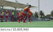 Купить «Hockey players preparing before a game», видеоролик № 33805943, снято 18 ноября 2019 г. (c) Wavebreak Media / Фотобанк Лори
