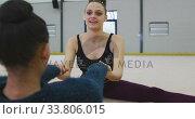 Купить «Female gymnasts performing at sports hall», видеоролик № 33806015, снято 17 сентября 2019 г. (c) Wavebreak Media / Фотобанк Лори