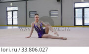 Купить «Teenage female gymnast performing at sports hall», видеоролик № 33806027, снято 17 сентября 2019 г. (c) Wavebreak Media / Фотобанк Лори