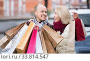Portrait of positive pleasant mature couple standing. Стоковое фото, фотограф Яков Филимонов / Фотобанк Лори